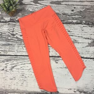 Lululemon Orange Capri w/ twisted mesh side panels